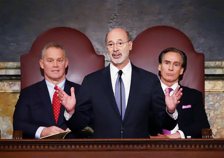 Pennsylvania Budget-6 Gov. Tom Wolf, center, delivers his budget address for the 2016-17 fiscal year to a joint session of the Pennsylvania House and Senate last week.
