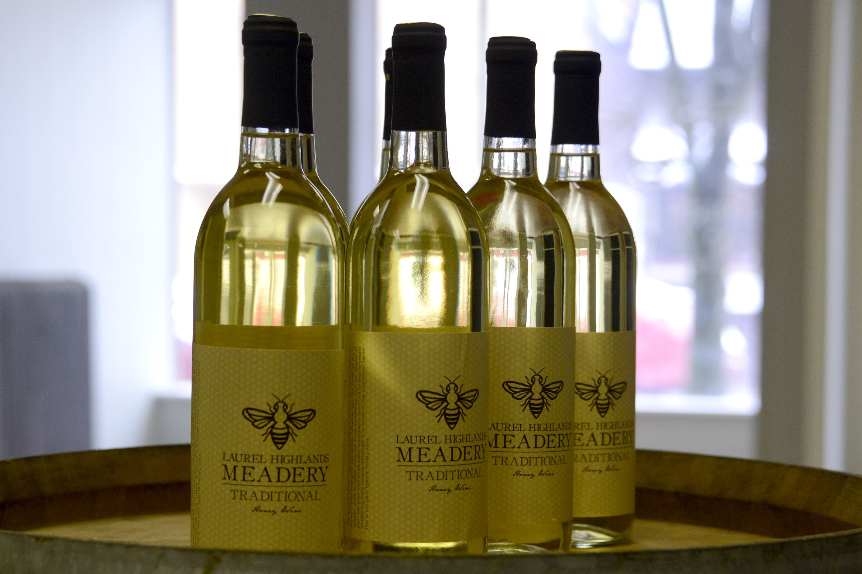 20160209dsMeaderyMag04-3 A closeup of a group of bottles of Laurel Highlands Meadery's traditional honey wine.