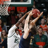 Miami's Ebuka Izundu (15) blocks a shot by Pitt's Rafael Maia in the first half Tuesday night in Coral Gables, Fla.