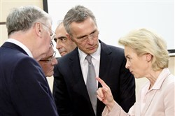 German Defense Minister Ursula von der Leyen, right, speaks Wednesday with, from left, British Secretary of State for Defense Michael Fallon, U.S. Secretary of Defense Ash Carter and NATO Secretary General Jens Stoltenberg during a meeting of the North Atlantic Council at NATO headquarters in Brussels.
