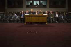 Director of National Intelligence James Clapper, left, accompanied by Defense Intelligence Agency Director Lt. Gen. Vincent Stewart, testifies on Capitol Hill in Washington, D.C., on Tuesday before a Senate Armed Services hearing on worldwide threats.