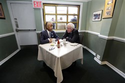 The Rev. Al Sharpton talks with Democratic presidential candidate and Vermont Sen. Bernie Sanders on Wednesday at a breakfast meeting at Sylvia's Restaurant in the Harlem neighborhood of New York.