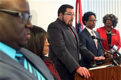 Ferguson Mayor James Knowles III, center, speaks Wednesday at the City of Ferguson Community Center about the vote in favor of revisions to the DOJ agreement. With him are, from left, City Manager DeCarlon Seewood, Councilwoman Laverne Mitchom, Mr. Knowles, Councilman Wesley Bell and Councilwoman Ella M. Jones.