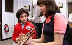 "Mt. Lebanon High school graduate Cecilia Larson teaches a youngster how to play trumpet in an upcoming episode of ""Daniel Tiger's Neighborhood"" on PBS."