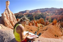 "Rachel Pohl paints landscapes of Bryce Canyon in Utah in the movie ""National Parks Adventure."""