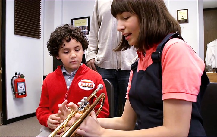 "daniel tiger larson 02102016 Mt. Lebanon High school graduate Cecilia Larson teaches a youngster how to play trumpet in an upcoming episode of ""Daniel Tiger's Neighborhood"" on PBS."
