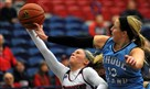 Duquesne guard Chassidy Omogrosso is fouled by Rhode Island guard Kallie Banker in second half action in 61-56 win.