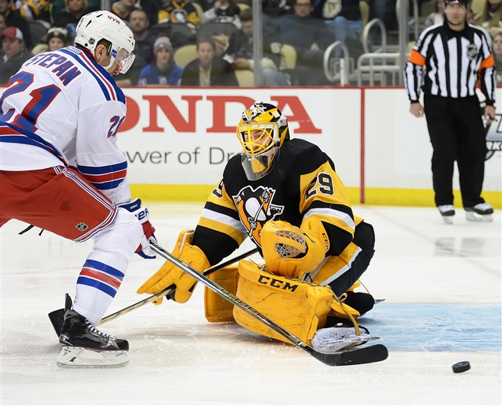 20160210pdPenguinsSports04 Penguins goaltender Marc-Andre Fleury makes save against the Rangers.