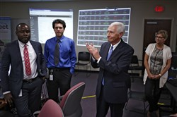 Steve Beshear, then governor of Kentucky, during a visit to the state's health insurance exchange headquarters, Kynect, to thank employees for their success with enrollments in Frankfort, Ky., on Oct. 14, 2013.