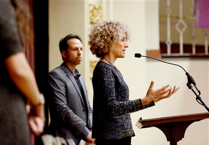 "Leslie Aizenman, director of refugee and immigrant services for Jewish Family & Children's Service of Pittsburgh, fields a question Thursday during ""A Syrian Summit"" held at East Liberty Presbyterian Church. At left is event organizer Kevin Caridad, chairman of the southwest division of the Pennsylvania National Association of Social Workers."