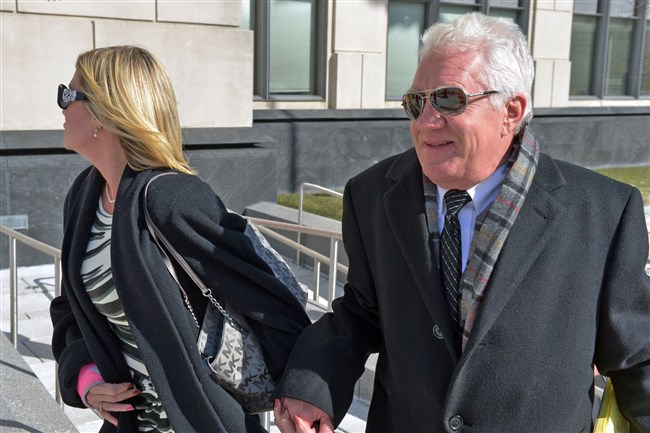 Former Freedom Industries owner and president Dennis Farrell, right, walks into Federal Court  with an unidentified woman in Charleston, W.Va., on Thursday.