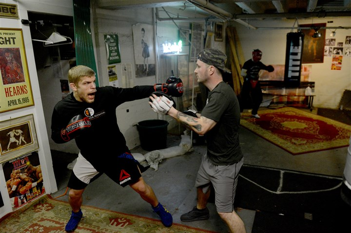 20160209MWHboxingSports05-4 Chris Dempsey, left, an Ambridge resident and former All-American college wrestler turned MMA fighter, is on the main card for UFC Fight Night 84 on Feb. 27 in London.