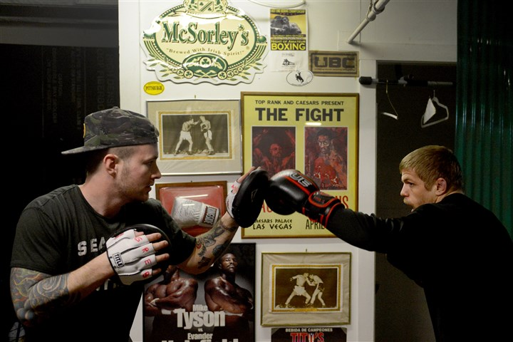 20160209MWHboxingSports06-5 UFC fighter Chris Dempsey of Ambridge, right, works on his boxing technique with trainer/promoter Matt Leyshock at the Conn-Grebb Boxing Club in North Oakland on Feb. 9. Dempsey, a former All-American college wrestler turned MMA fighter, is on the main card for UFC Fight Night 84, which will be held Feb. 27 in London.