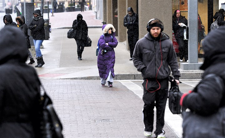 20160212rldColdWeather01 Pedestrians cope with the wintry weather Friday along Stanwix Street, Downtown.