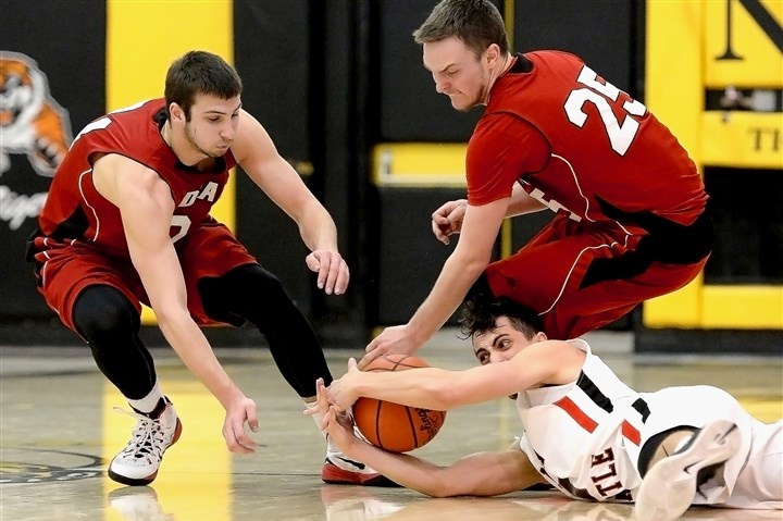 20150310mfnewcastlesports04-3 New Castle's Micah Fulena grabs a loose ball against Indiana's Blake Shields and Kevin Jack in a playoff game last season at North Allegheny.