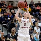 Quigley's Gabbie Smith gets a shot up against Imani Christian Saturday at North Allegheny.
