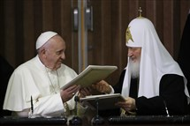 Pope Francis, left, and Russian Orthodox Patriarch Kirill exchange a joint declaration on religious unity at the Jose Marti International airport in Havana on Friday.
