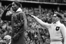 U.S. gold-medal winner Jesse Owens stands on the podium next to German silver medalist Lutz Long at the 1936 Olympics in Berlin. Afterward, Mr. Owens and Mr. Long walked arm in arm around the playing field.