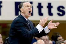 Pitt head coach Jamie Dixon applauds his team against Virginia Tech in the second half Sunday at Petersen Events Center.