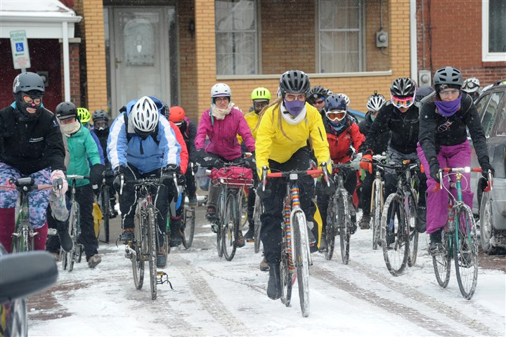 "20160213lf-Bike02-3 Cyclists start at the third annual ""Frigid Bitch"" alleycat cycling race in Lawrenceville on Saturday."