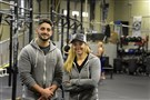 Gabriel Trbovich and Jennifer Murzyn pose after an afternoon session at their CrossFit Facility on the South Side.