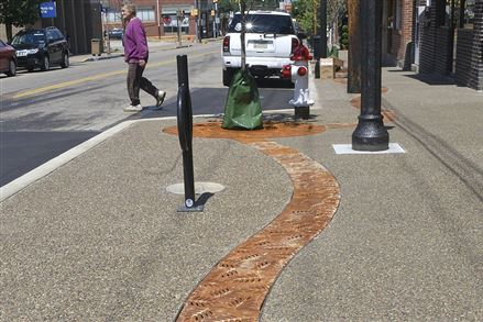 New grates, catch basins and trees are laid out in Etna.