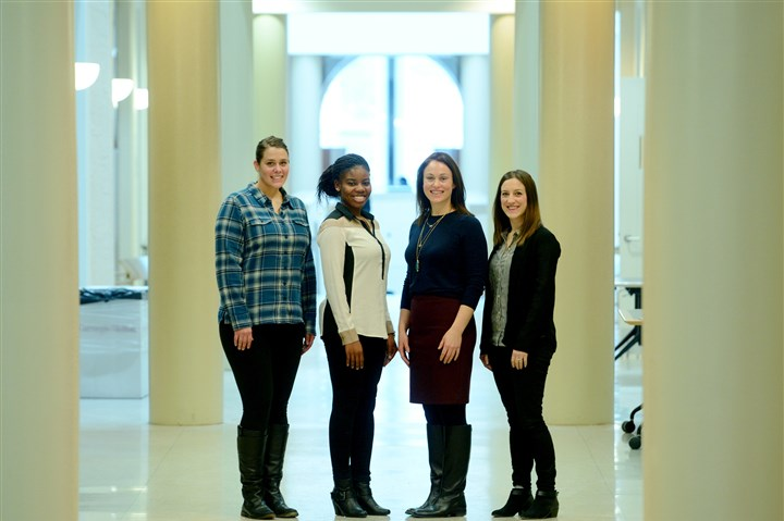 20160215MWHconferenceBiz01 Michael Henninger/Post-Gazette 20160215MWHconference Biz From left, Carnegie Mellon University graduate students Katie Moritz, 26, Samantha Grant, 25, Lauretta Wild, 33, and Megan O'Rourke, 29, pose for a portrait inside of CMU's Tepper School of Business in Squirrel Hill on Monday, Feb. 15, 2016. Wild, O'Rourke, Grant and Moritz are the organizers behind a conference to help mid-career level women make the jump to management that will be held this weekend.
