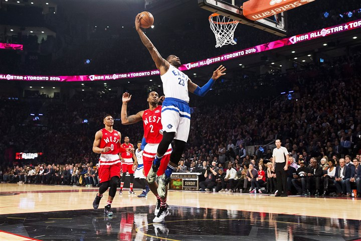James0215d Cavaliers forward Lebron James of the East slam dunks in the first half of the NBA All-Star game Sunday in Toronto.