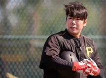Pirates shortstop Jung Ho Kang waits to hit during workouts at Pirates City, Bradenton Florida.