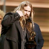 Chris Stapleton accepts the award for best country album for Traveller at the 58th annual Grammy Awards in 2016.
