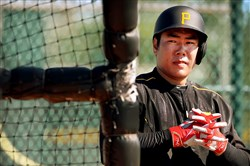 The Pirates' Jung Ho Kang waits to hit during workouts at Pirates City in Bradenton Fla.