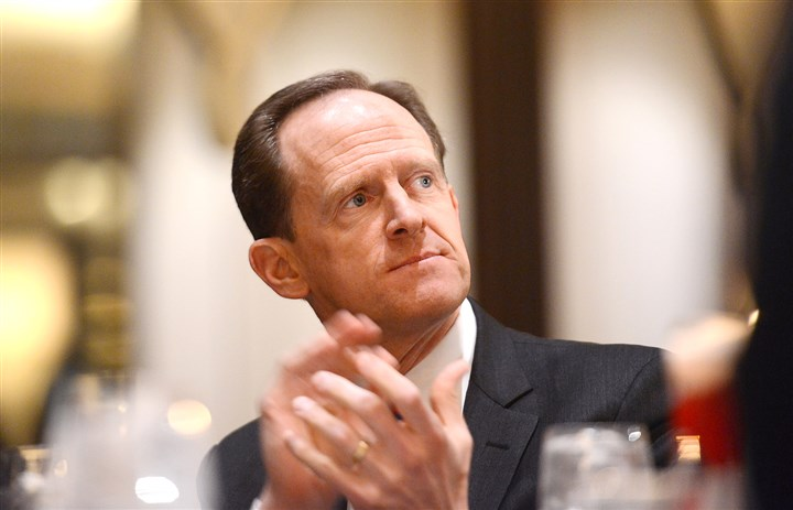 20160215JRRepublican4-2 U.S. Sen. Pat Toomey, R-Pa., applauds during the Spirit of Lincoln Dinner on Monday at the Westin Convention Center, Downtown.