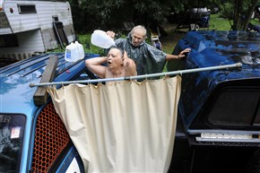 In this July 2012 photo, Fred and Janet McIntyre (and their neighbors) in the Woodlands were using bottled water because they said their well water was making them sick.