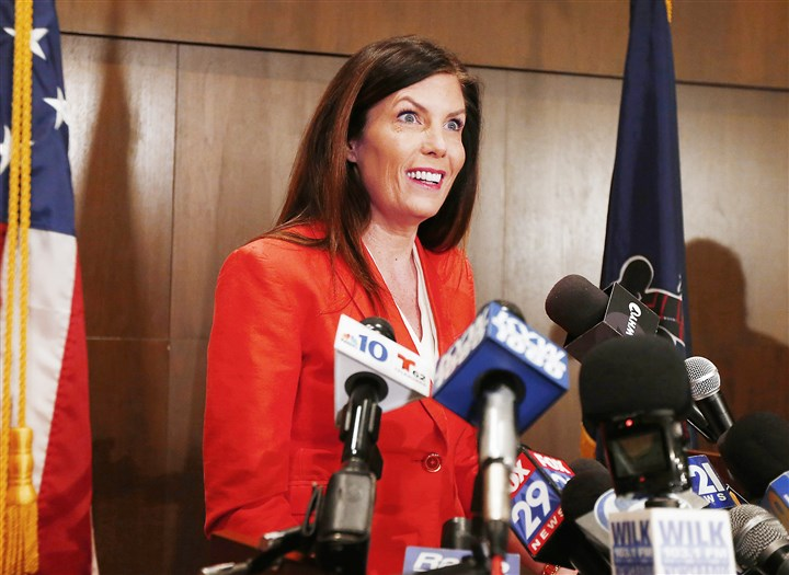 Kane0217a Attorney General Kathleen Kane announces her decision at a news conference Tuesday in Scranton.