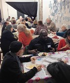 "Muslims and non-Muslims gather at the Assemble Gallery in Garfield for a ""Meet Your Muslim Neighbors"" potluck meal."