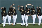 Pirates pitchers and catchers stretch after reporting to spring training last year.