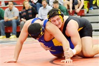 Montour's Roman Macek, back, is hoping to do what his brother Cole could not ... win his match for the WPIAL team in the Pittsburgh Wrestling Classic.
