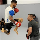 Cody Garbrandt, left, works out  with his uncle Robert Meese during a UFC open practice session Friday at Stout Training Pittsburgh, two days before Sunday's UFC event at Consol Energy Center.