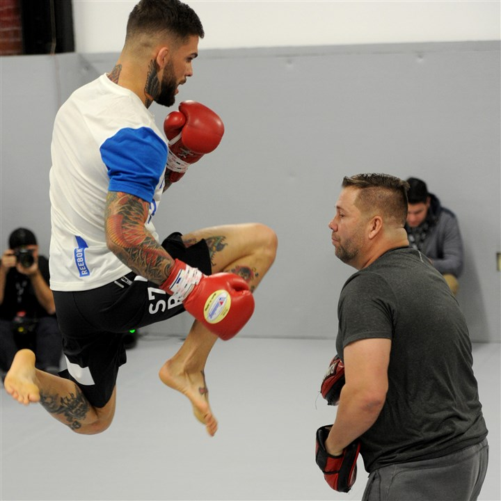 20160219MWHufcSports06-5 Cody Garbrandt, left, works out with his uncle Robert Meese during a UFC open practice session Friday at Stout Training Pittsburgh, two days before Sunday's UFC event at Consol Energy Center.