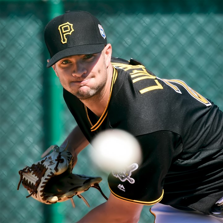 20160219pdPiratesSports09 Pirates left-hander Cory Luebke throws off the mound during morning workouts at Pirate City in Bradenton, Fla.