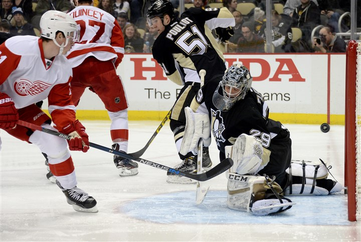 20160218mfpenssports04 The Red Wings' Dylan Larkin scores on Penguins goaltender Marc-Andre Fleury in the second period Thursday at Consol Energy Center.