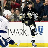 The Penguins' Tom Kuhnhackl celebrates his short-handed goal on Lightning goaltender Ben Bishop during a February game at Consol Energy Center.