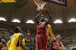 Oklahoma forward Khadeem Lattin grabs a rebound in the second half of Saturday's victory at West Virginia in Big 12 action.