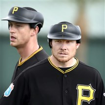 Pirates pitcher Jarod Hughes, left, with reliever Mark Melancon in spring training, doesn't agree with the commissioner's pace-of-play suggestion of limiting the number of relief pitchers used in games.