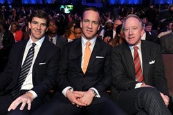 New York Giants quarterback Eli Manning, Denver Broncos quarterback Peyton Manning and their father, former NFL quarterback Archie Manning.