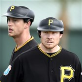 Pirates pitchers Jared Hughes (rear) and Mark Melancon wear the new pitcher protective cap at a recent morning workout at Pirate City Bradenton Florida.