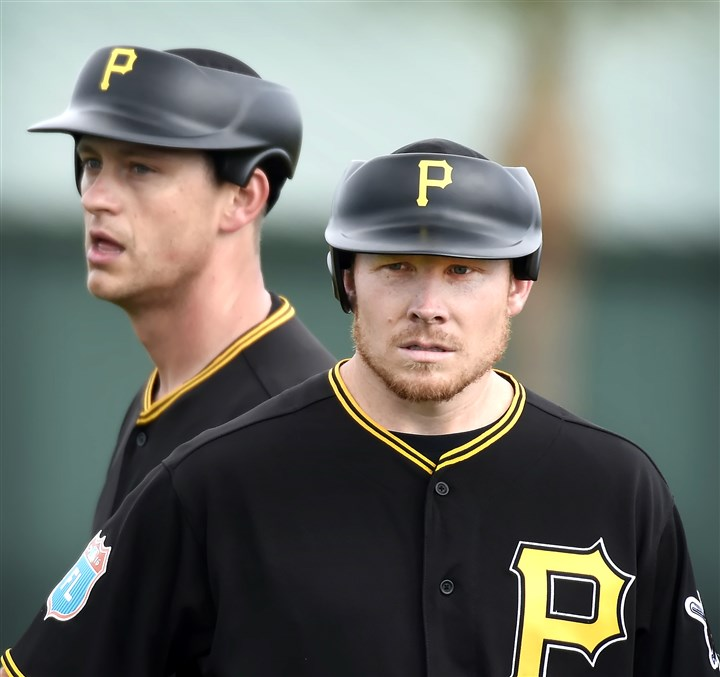 20160221pdPiratesSports01 Pirates relievers Jared Hughes, left, and Mark Melancon tested out new headgear technology for pitchers during their bullpen sessions Sunday at Pirate City in Bradenton, Fla.
