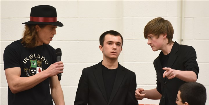 "20160221radStSebastianNorth08-7 From left, John Galbraith, Dominic Melchiorre and Jack Wells debate the problems created by Jesus Christ as students in the St. Sebastian Youth Ministry rehearse ""Jesus Christ Superstar."""