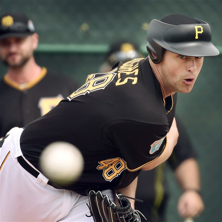 20160221pdPiratesSports06-5 Jared Hughes said he will continue to test out this new helmet technology for pitchers in some spring training games.