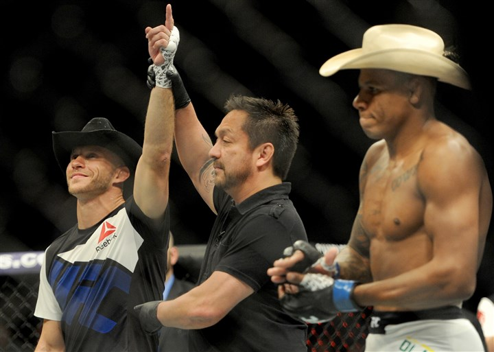 20160221MWHufcfightSports92-11 Donald Cerrone is declared the winner against Alex Oliveira in their UFC Fight Night bout held at Consol Energy Center.
